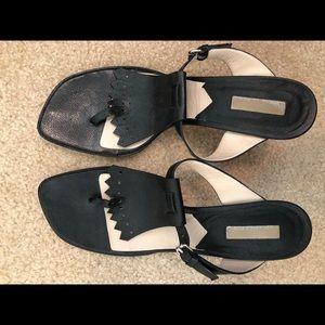 Michael Kors black heels with golf tassel